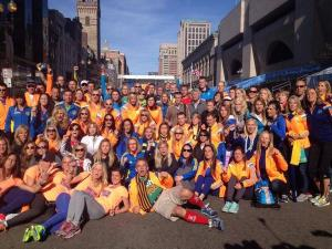 Runners join in a group photo wearing a combination of 2013 and 2014 Adidas jackets (Photo courtesy of: Deseret News http://www.deseretnews.com/article/865601516/2014-Boston-Marathon-helped-us-all-heal.html?pg=all)