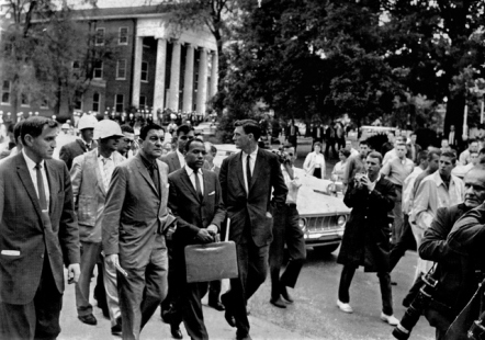 While registering for classes James Meredith is met by a passionately angry crowd in front of Ole Miss' famed Lyceum.